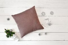 Pillow on a white wooden christmas background. Flat lay, top view photo mockup.  stock image