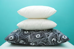 Pillows. Stack of 3 pillows on colored background stock image