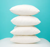 Pillows. Stack of four pillows on colored background stock images