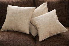 Pillows. Beige pillows on a sofa Royalty Free Stock Photo