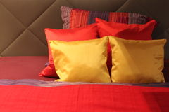 Pillows. Colorful pillows on the bed lighted Royalty Free Stock Photo