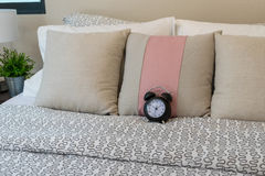 Pillows and alarm clock on bed Royalty Free Stock Photo