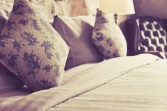 Pillows on an antique luxury bed Royalty Free Stock Photos