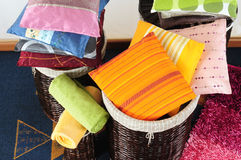 Pillows in basket. Bunch of cushions in a straw basket Stock Image