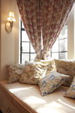 Pillows on the bay window Royalty Free Stock Photo