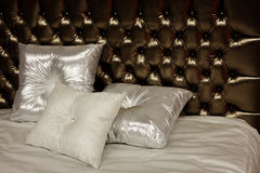 Pillows on a bed. Satin pillows on luxurious bed Stock Images