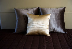 Pillows in bed Stock Images