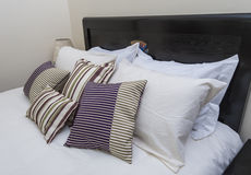 Pillows on a bed. Pillows and cushions on a bed royalty free stock photo