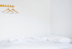Pillows and bed in empty bedroom stock image