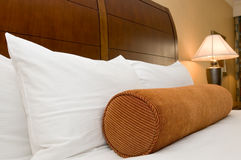 Pillows on bed in hotel room Royalty Free Stock Photography