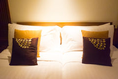 Pillows on bed in modern bedroom design Stock Images