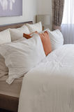 Pillows on bed in modern living room Royalty Free Stock Photos