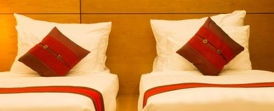Pillows in bed at night. Red pillows in bed at night Royalty Free Stock Image