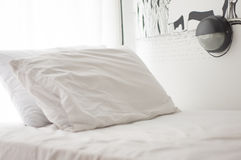 Pillows on a bed room. White pillows on a bed Comfortable soft pillows on the bed Stock Images
