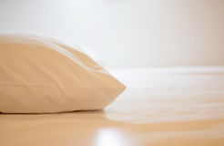 Pillows on a bed. White pillows on a bed Comfortable soft pillows on the bed Stock Photos