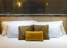 Pillows on beds in hotel Stock Image