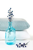 Pillows and a blue vintage  bottle Royalty Free Stock Photo