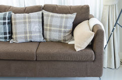 Pillows on brown modern sofa in living room Stock Photo