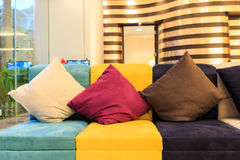 Pillows on colorful leather sofa Royalty Free Stock Image