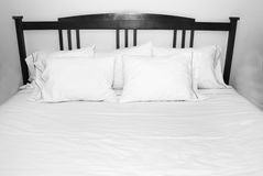 Pillows of Comfort on White Bed Royalty Free Stock Photos