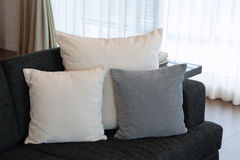 Pillows on the couch. Pillows on the sofa against the background of day window Royalty Free Stock Photo
