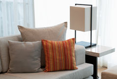 Pillows on the couch. Pillows on the sofa against the background of day window Stock Photos