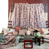 Pillows and curtains. Interior with bunch of pillows and floral curtains Royalty Free Stock Images