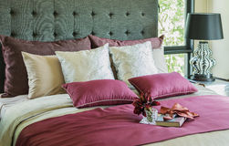 Pillows and decorative tray on the bed Stock Image