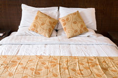 Pillows on double bed in bedroom royalty free stock photo