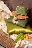 Pillows in east interior with fruits Royalty Free Stock Photos