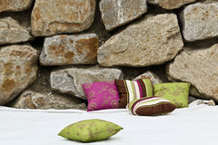 Pillows in front of rocks Royalty Free Stock Photos