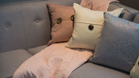 Pillows on a grey modern corner sofa Royalty Free Stock Image