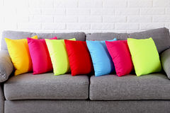 Pillows on grey sofa Royalty Free Stock Photos