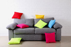 Pillows on grey sofa Stock Photo