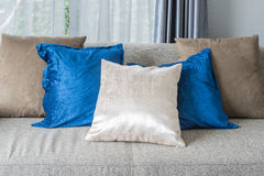 Pillows on grey sofa in modern living room Royalty Free Stock Photo