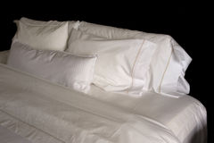 Pillows on a hotel bed. Five white pillows on a king size hotel bed Stock Images