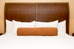 Pillows on hotel bed. Generic hotel/motel room with queen-size bed Royalty Free Stock Photography