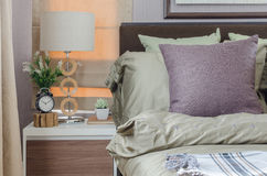 Pillows on king size bed with modern white lamp Royalty Free Stock Photo