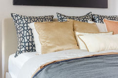 Pillows on modern bed with grey blanket Royalty Free Stock Photos