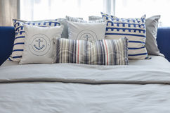 Pillows on modern blue bed in bedroom Stock Images