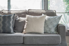 Pillows on modern grey sofa in living room Stock Photography