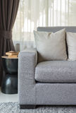 Pillows on modern grey sofa in living room Stock Image