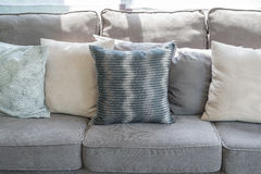 Pillows on modern grey sofa in living room Royalty Free Stock Images