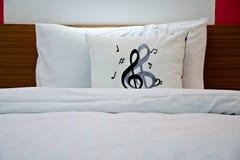 Pillows with music notes stock photos