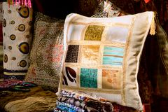 Pillows with needlecraft Stock Photos