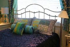 Free Pillows On Purple Bedspread Stock Photos - 2927453