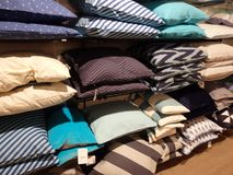 Pillows on a shelf in a shop. Home good store filled with colourful blue white brown pillows on a shelf in a large store Stock Photography