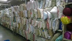 Pillows on shelves selling at store Stock Photography