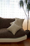 Pillows on a Sofa. And white curtain Stock Photo