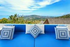 Pillows on sofa at terrace Stock Image